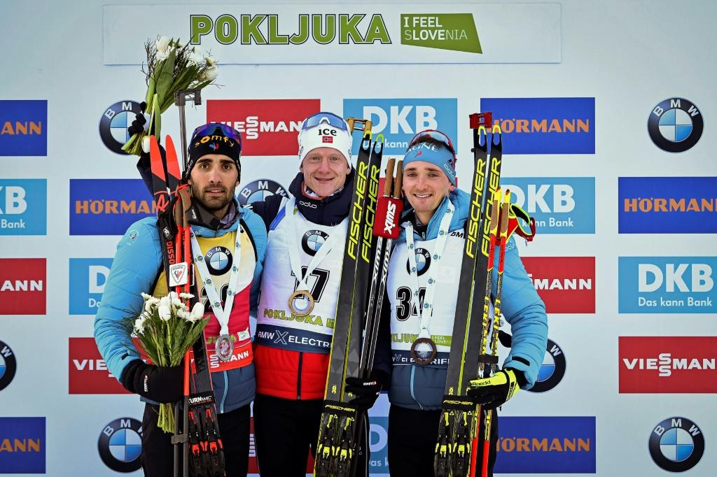 'This podium is for him, I am sure he is proud of us,' French biathlete Fabien Claude (R) said of his missing father, Gilles Claude, after winning a bronze medal at Thursday's Biathlon World Cup in Slovenia