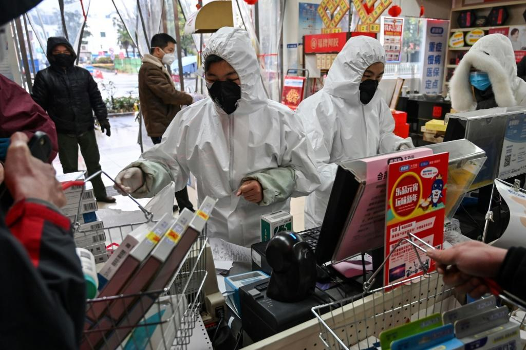 Pharmacy workers wear protective clothes and masks in Wuhan, the epicentre of the latest deadly virus outbreak to have jumped from animals