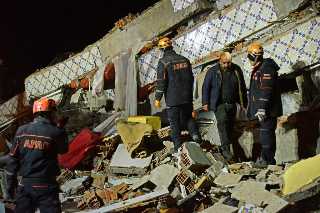 Rescue teams searched through the night for survivors trapped in the rubble of a collapsed building