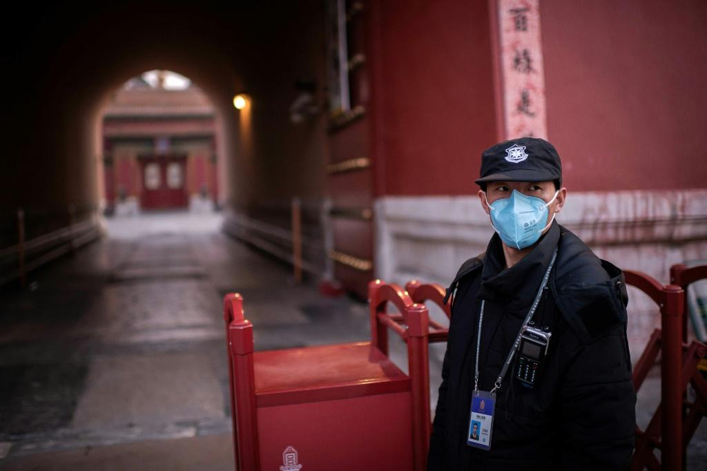The virus has continued to spread across China despite the drastic travel restrictions and people wearing face masks