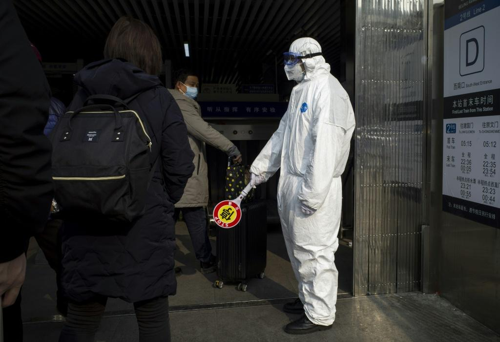 Security personnel in China are wearing protective clothing as they to help stop of the deadly virus