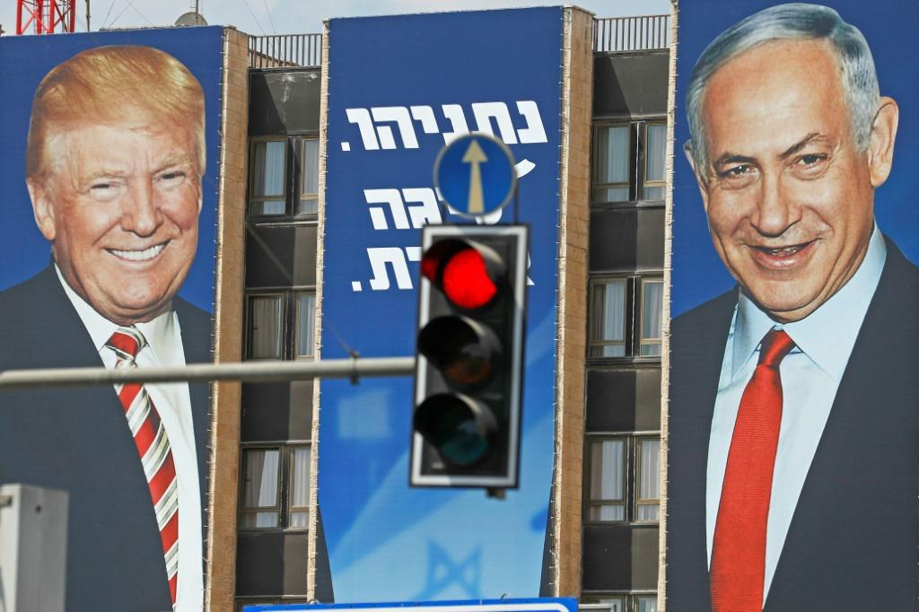 This picture taken on September 14, 2019 shows an Israeli election banner bearing the portraits of US President Donald Trump (L) and Prime Minister Benjamin Netanyahu hanging on a building facade in Jerusalem
