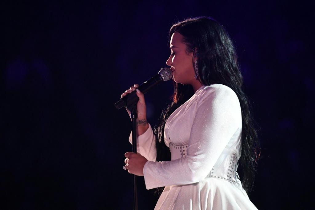 Demi Lovato -- in a stunning white Christian Siriano gown -- brought the Grammys audience to their feet with her raw performance