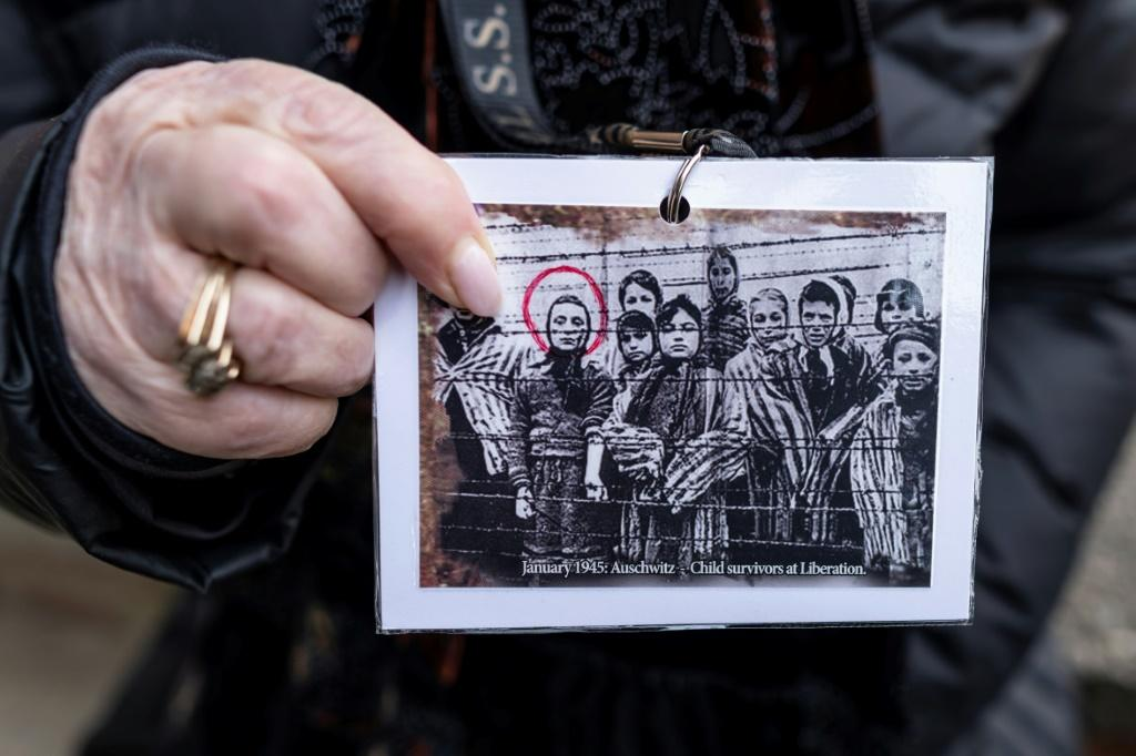 Holocaust survivor and former prisoner of the Nazi death camp Auschwitz-Birkenau, Miriam Ziegler (Friedman), shows a picture of her and other prisoners just after the camp was liberated