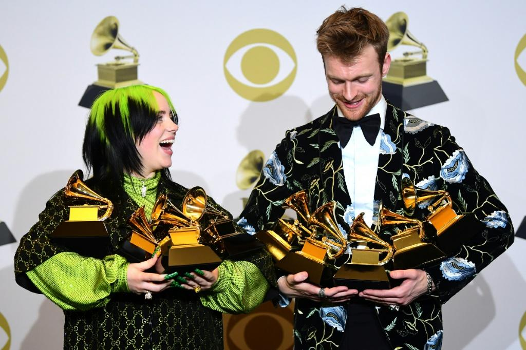 US singer-songwriter Billie Eilish and her brother Finneas O'Connell cradle their trophies after scoring big at the 62nd annual Grammys