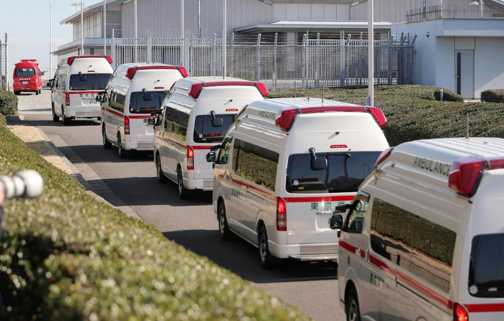 Ambulances arrive at Haneda airport in Tokyo to meet a second charter flight carrying Japanese citizens from the Chinese city of Wuhan