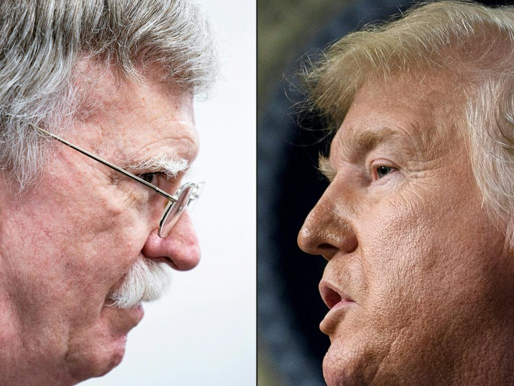 Former national security advisor John Bolton (l) says President Donald Trump wanted to freeze military aid to Ukrain until Kiev opened an investigation into Joe Biden, the frontrunner for the Democratic presidential nomination