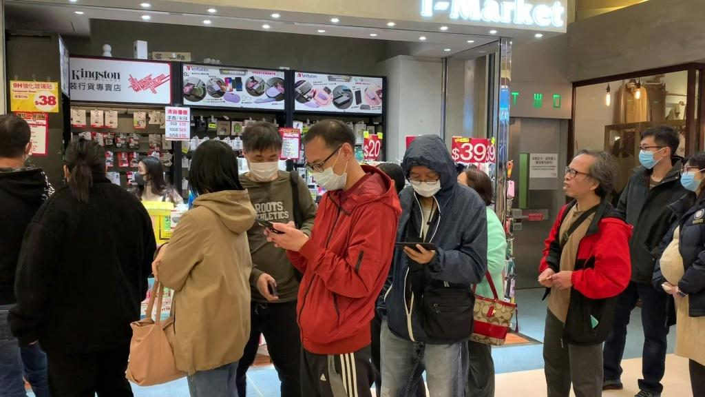 Long queues form at pharmacies in Hong Kong as fears spread through the crowded metropolis over China's new coronavirus epidemic.