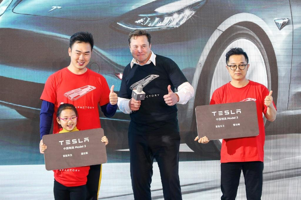Tesla CEO Elon Musk (C), shown in Shanghai last month, has enjoyed a positive run in recent months at the expense of Detroit's Big Three