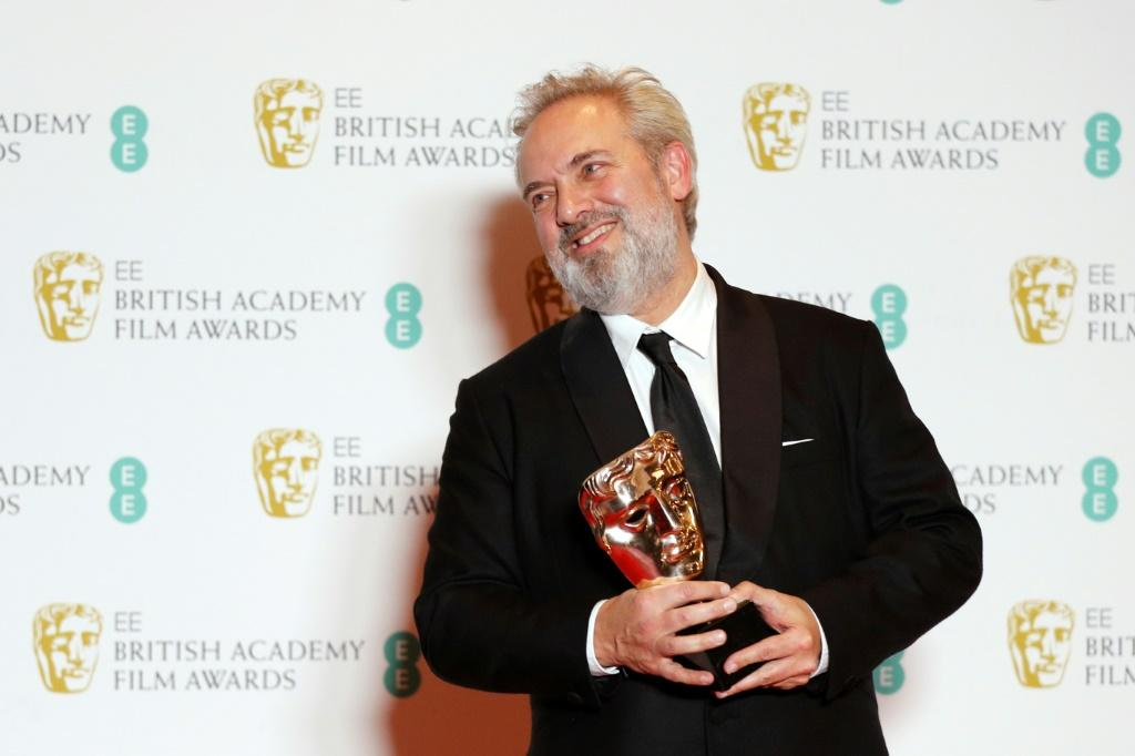 "British filmmaker Sam Mendes is leading the charge into Oscars night with his war epic ""1917"" -- he is seen here with his Bafta award for best director"