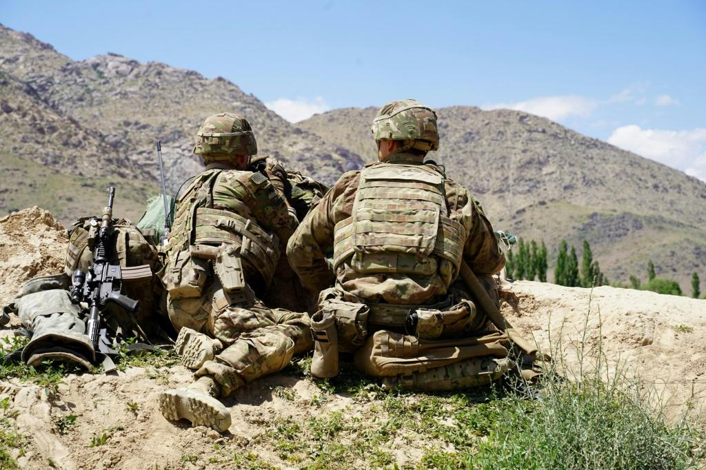 """In this file photo taken on June 6, 2019, US soldiers look out over hillsides in Nerkh district of Wardak province; US and Afghan troops have come under """"direct fire"""" in eastern Afghanistan, a US military official says"""