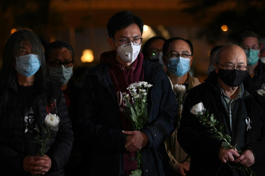 People attend a vigil in Hong Kong for dead Chinese doctor Li Wenliang, who tried to warn about the new coronavirus