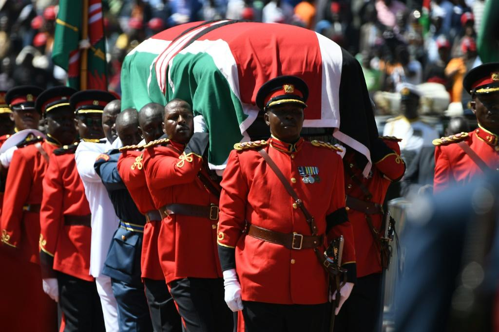 Military officers carried the coffin, which was draped with the national flag
