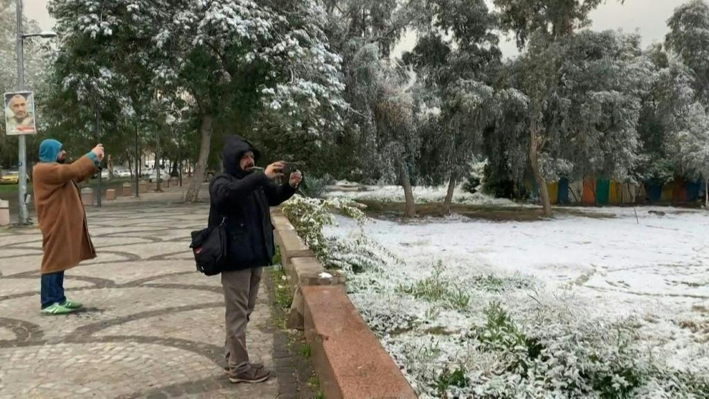 Residents of Baghdad rush to have snowball fights and take photographs as the Iraqi capital woke carpeted in white by only its second snowfall in a century