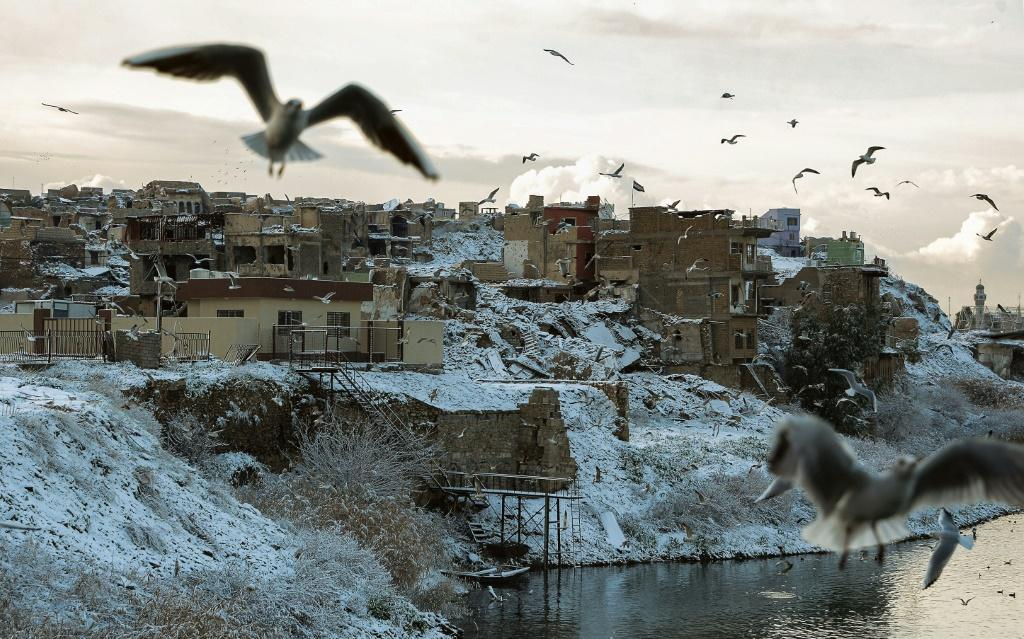 Snow carpets Iraq's main northern city of Mosul, nestled on the banks of the River Tigris