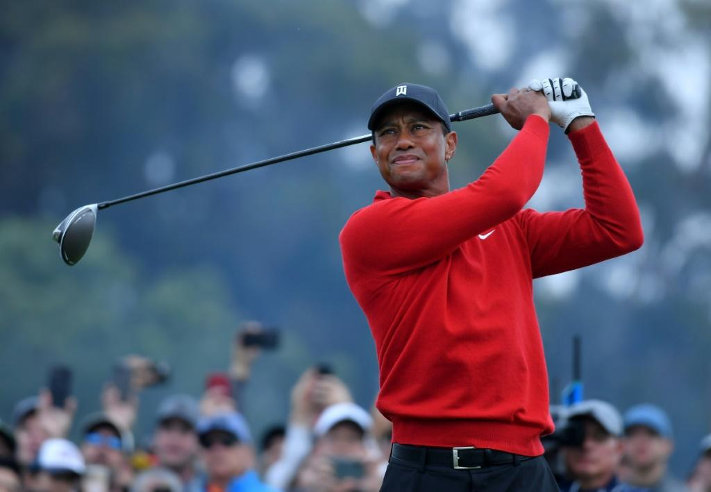"""Tiger Woods, seen here teeing off on the 18th hole at Torrey Pines, says finding a solution to golf's ever-increasing hitting distance is """"a delicate balancing act"""
