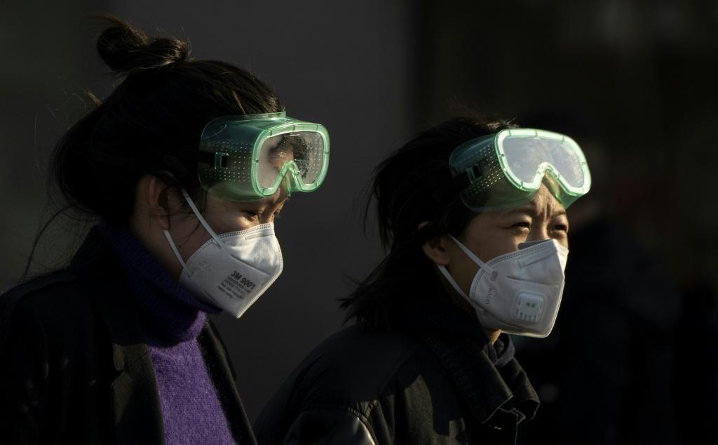 Neighbours are being encouraged to report on each other as the Chinese government seeks to halt the spread of the coronavirus