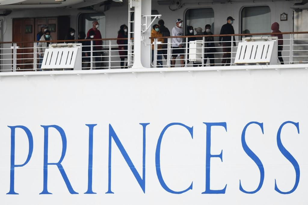 Passengers on the Diamond Princess are confined to their cabins except for brief outings on open decks wearing facemasks