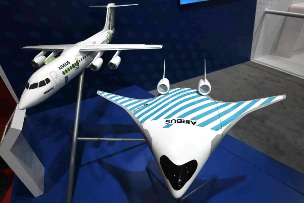 European plane maker Airbus has unveiled a model of a futuristic jet dubbed Maveric (right) which it says has the potential to cut fuel consumption by up to 20 percent compared to current single-aisle aircraft