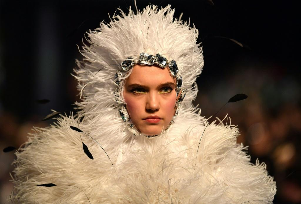There were dresses with trains, flowers, crystals and feathers galore at Quinn's show in central London