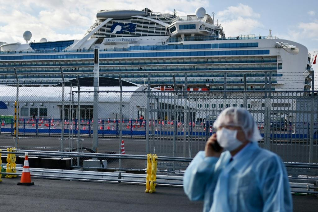 Japan faced a growing crisis as two passengers from a quarantined cruise ship died