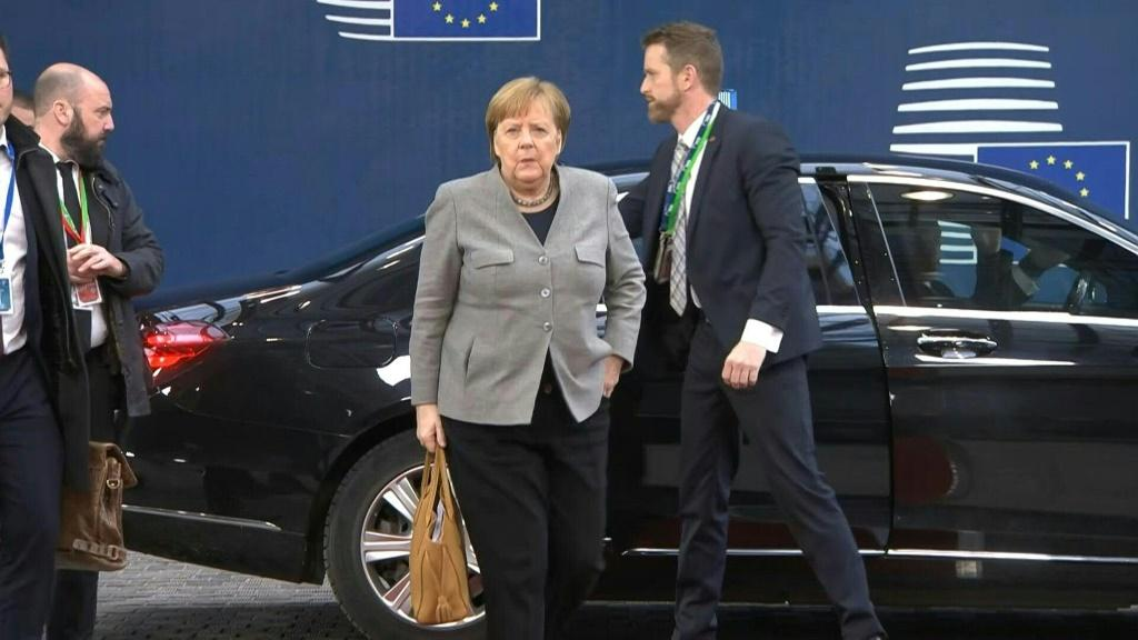 IMAGESGerman Chancellor Angela Merkel, French President Emmanuel Macron and EU Council chief Charles Michel arrive for the second day of a special summit on the bloc's longterm budget.