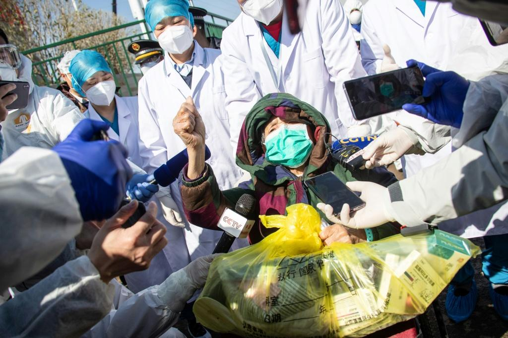 A recovered 83-year-old patient in a wheelchair is discharged from Leishenshan Hospital, a newly built makeshift hospital for novel coronavirus patients in Wuhan, the epicenter of the outbreak