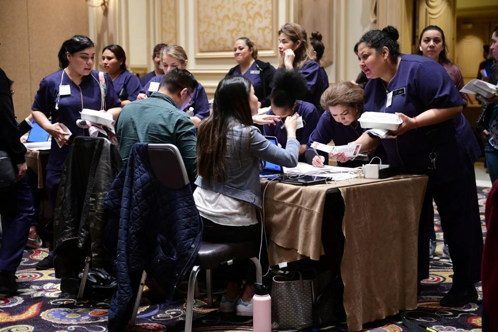 Workers at Las Vegas's luxurious Bellagio hotel checked in before taking part in Nevada's presidential caucuses