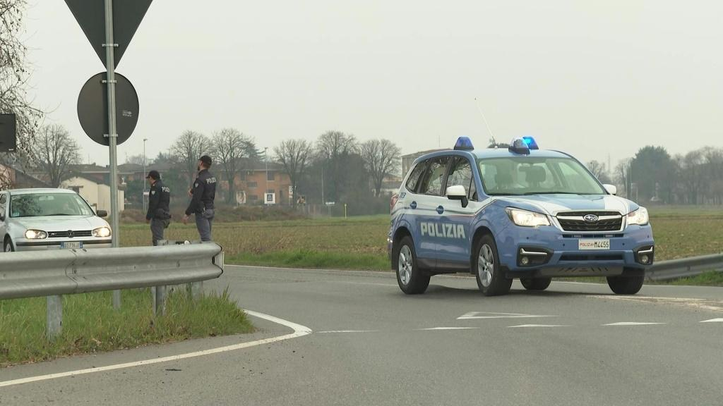 IMAGES Police cars patroll the area and install a checkpoint at the entrance of Casalpusterlengo, Lombardy, northern Italy. Tens of thousands of Italians are preparing for a week-long quarantine in the country's north as nerves begin to fray among the loc