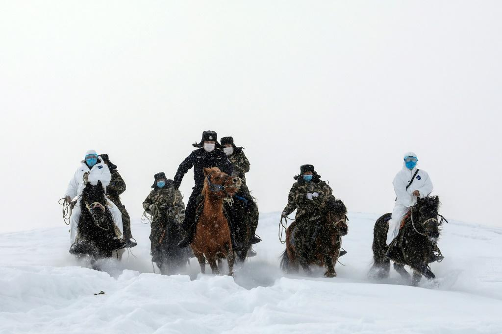 Mounted police visit residents who live in remote areas in Altay, farwest China's Xinjiang region, to promote awareness of the virus