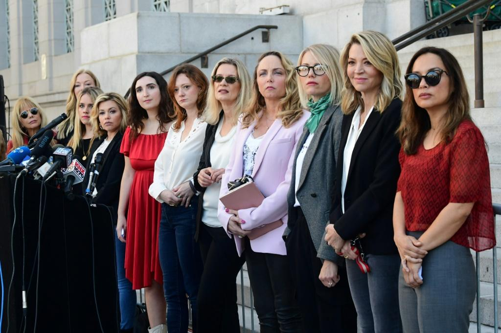 Harvey Weinstein was accused by dozens of women of sexual misconduct -- here, a group of them are seen in Los Angeles after his conviction in New York