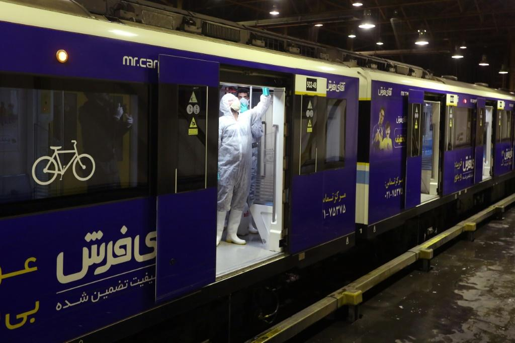 A Tehran municipality worker cleans a metro train to avoid the spread of the COVID-19 illness