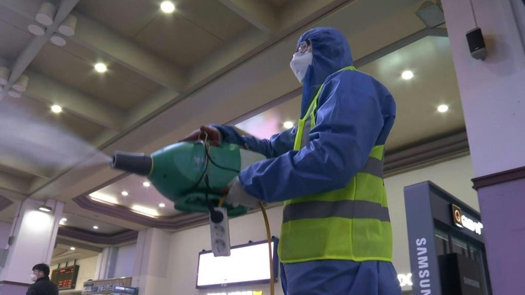 A worker sprays disinfectant at a railway station in Daegu, South Korea's epicentre of the coronavirus outbreak, as part of preventive measures against the spread of the virus
