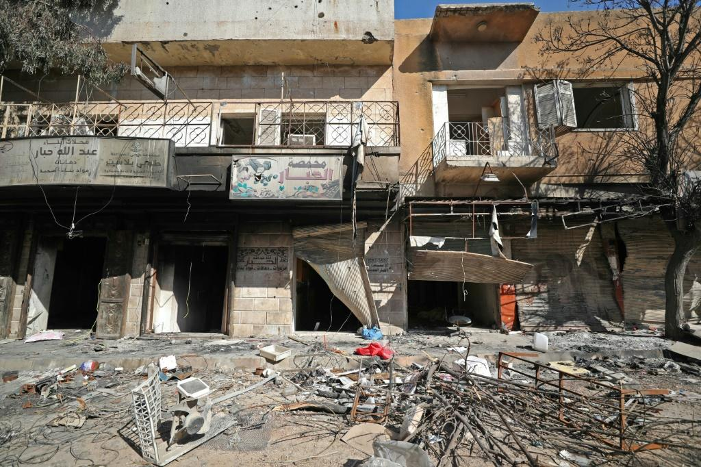 Damaged shops and rubble-strewn streets in the Idlib town of Saraqeb, which rebels re-entered in a reversal of one of the Syrian government's main gains in a devastating offensive