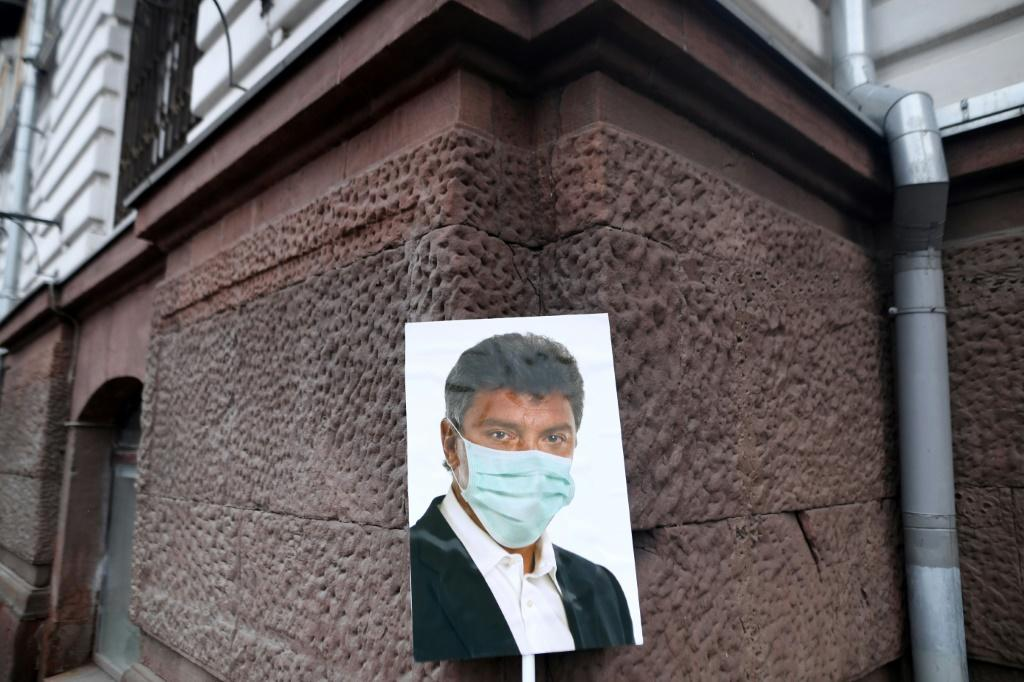 A picture of Boris Nemtsov wearing a facemask left during the rally in downtown Moscow