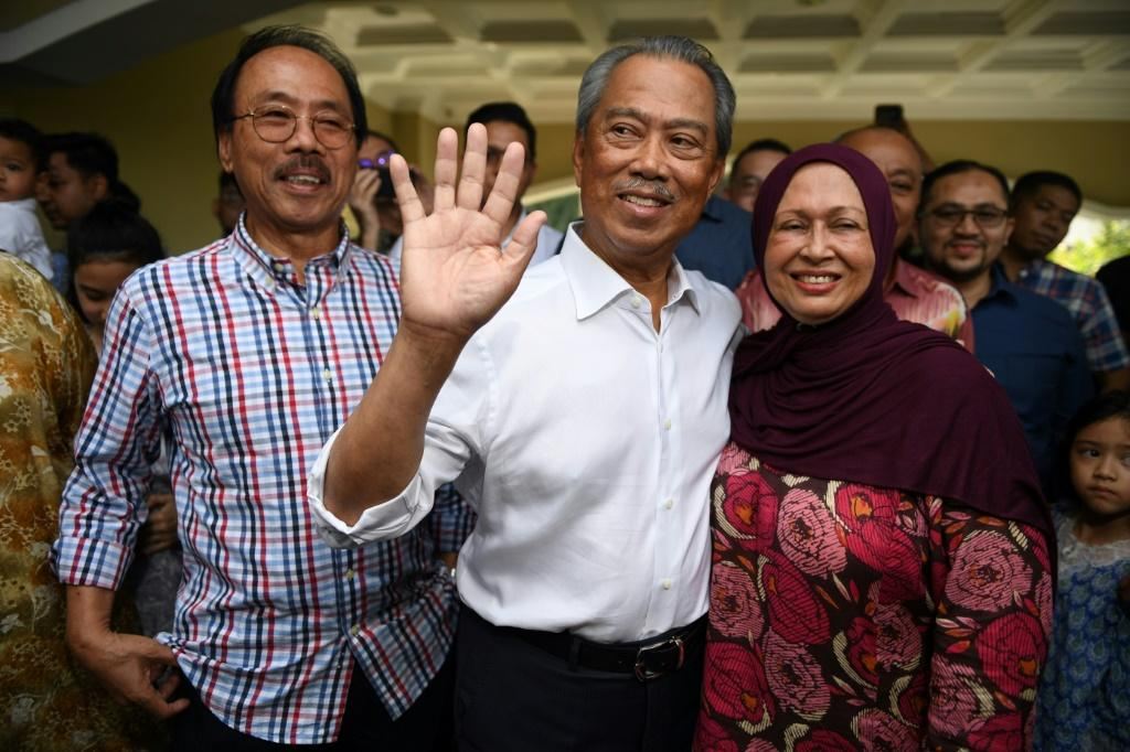 Former interior minister Muhyiddin Yassin (C) is set to become Malaysia's prime minister in a shock twist to a week of political chaos