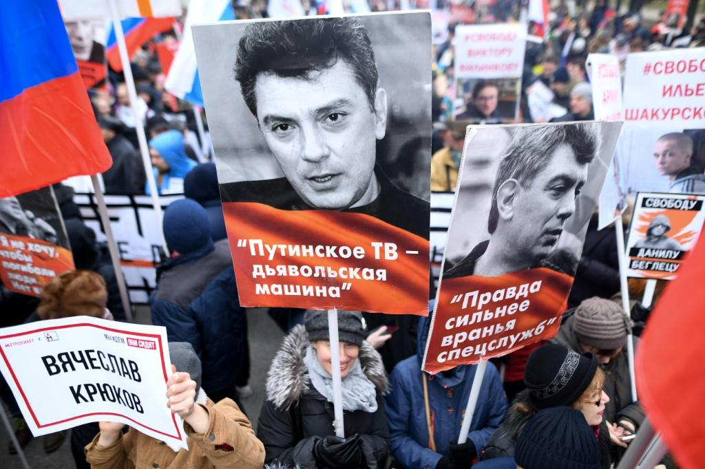 Opposition supporters attend a march in memory of murdered Kremlin critic Boris Nemtsov in downtown Moscow. It is the first such rally since Russia's Vladimir Putin announced controversial changes to the constitution in January.