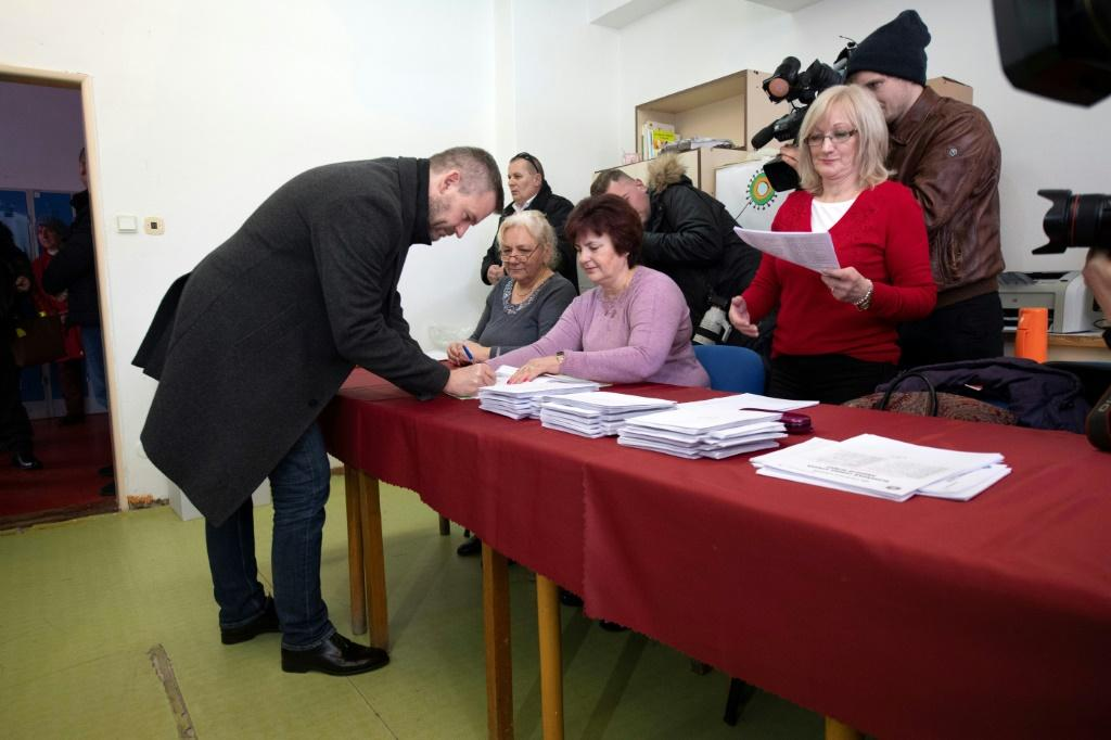 Slovakia's Prime Minister and election leader of the populist-left Smer-Social Democracy (Smer-SD) party, Peter Pellegrini votes in the parliamentary election.