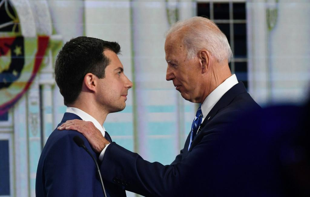 Former Indiana mayor Pete Buttigieg (L) has endorsed former US vice president Joe Biden for president, shortly after abandoning his own White House hopes