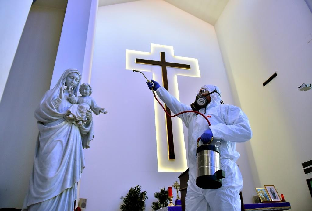 Sanitary workers disinfect a church in Beirut, Lebanon