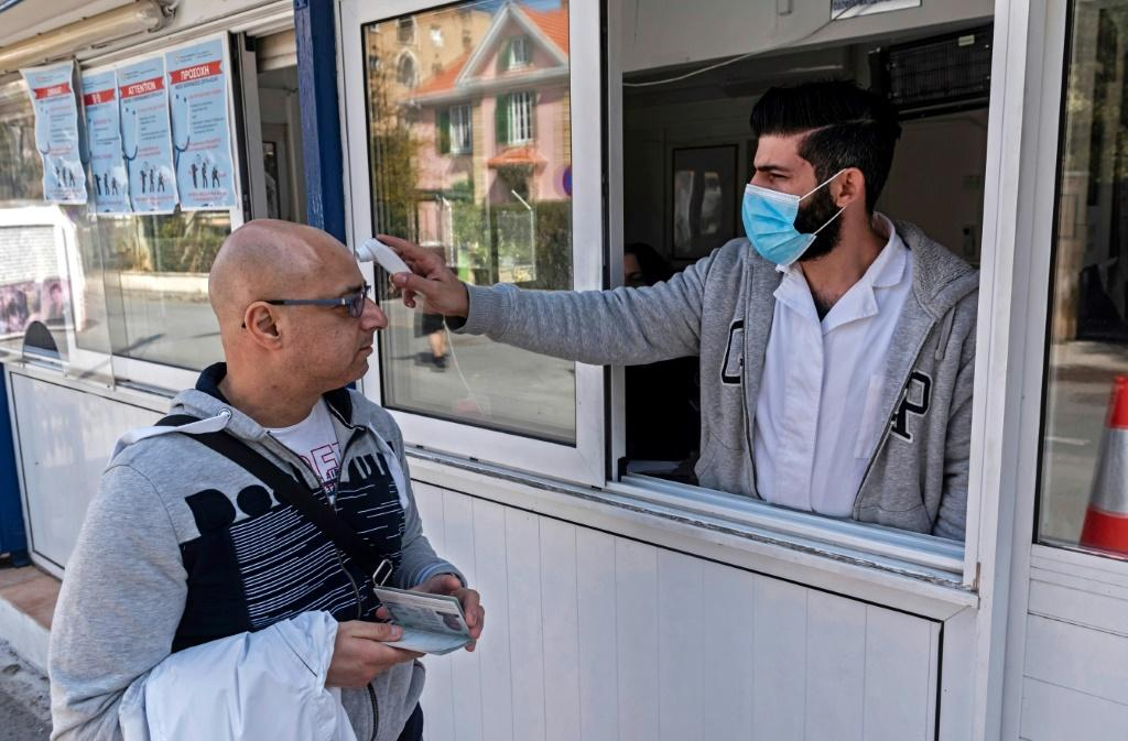 Cyprus locked down its largest hospital on Tuesday for 48 hours after a heart surgeon tested positive for coronavirus