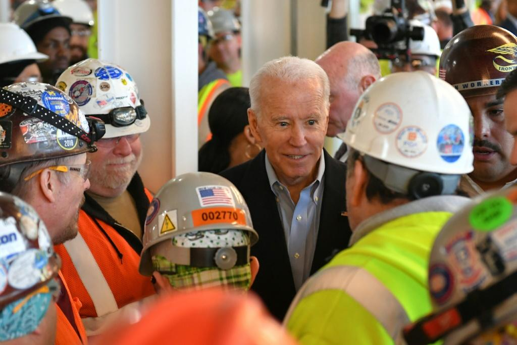 Democratic presidential candidate Joe Biden meets workers as he tours the Fiat Chrysler plant in Detroit