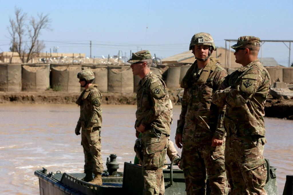 US army forces supervise during a training session at the Taji camp, north of Baghdad -- the site of Wednesday night's rocket attack