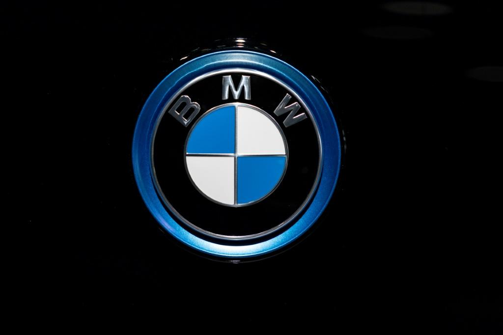 A BMW automobile logo is pictured January 9, 2020 in Brussels; The European Commission has accused BMW, Volkswagen and Daimler of avoiding competition with each other on technologies that reduce harmful emissions