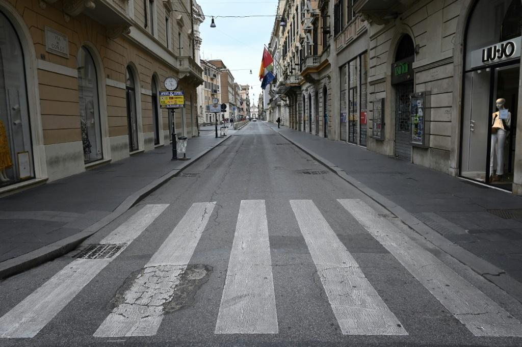 A deserted Via del Corso main shopping street in Rome, as Italy shut all stores except for pharmacies and food shops in a desperate bid to halt the spread of a coronavirus