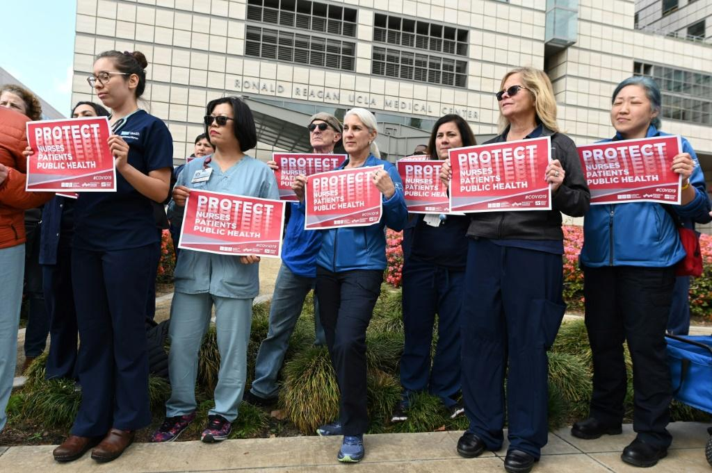 Nurses protest what they call the weak US response to the novel coronavirus outside the UCLA Medical Center in Los Angeles