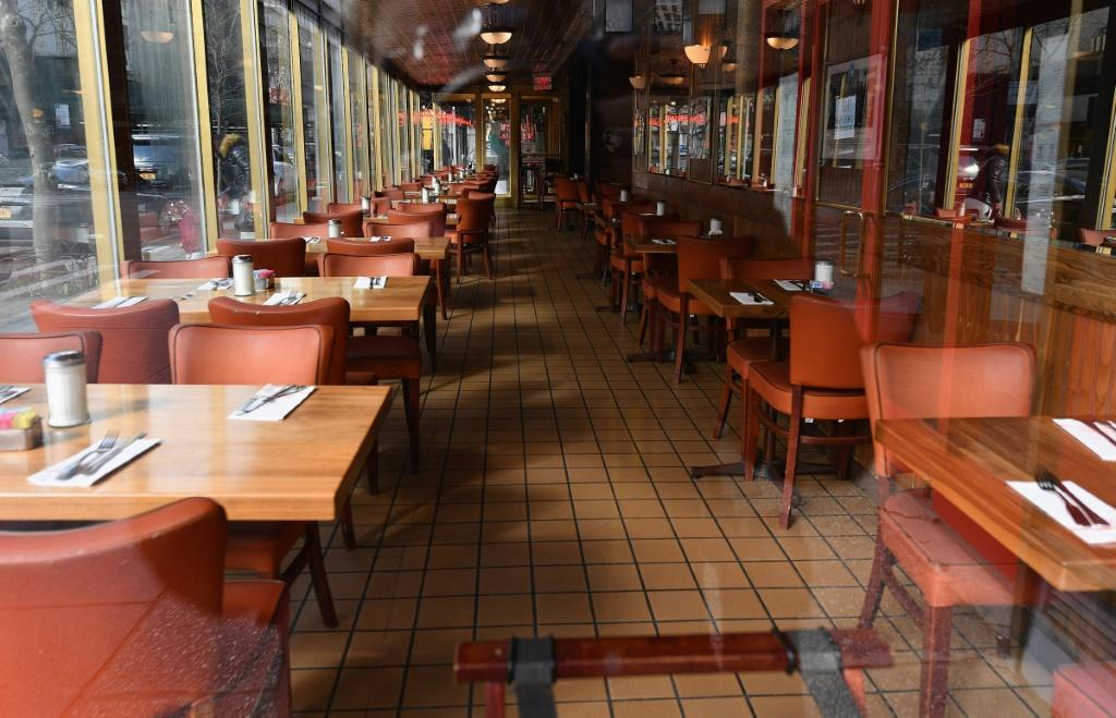 """View of an empty restaurant named """"Juniors"""" is seen on March 16, 2020 in the Brooklyn Borough of New York City"""