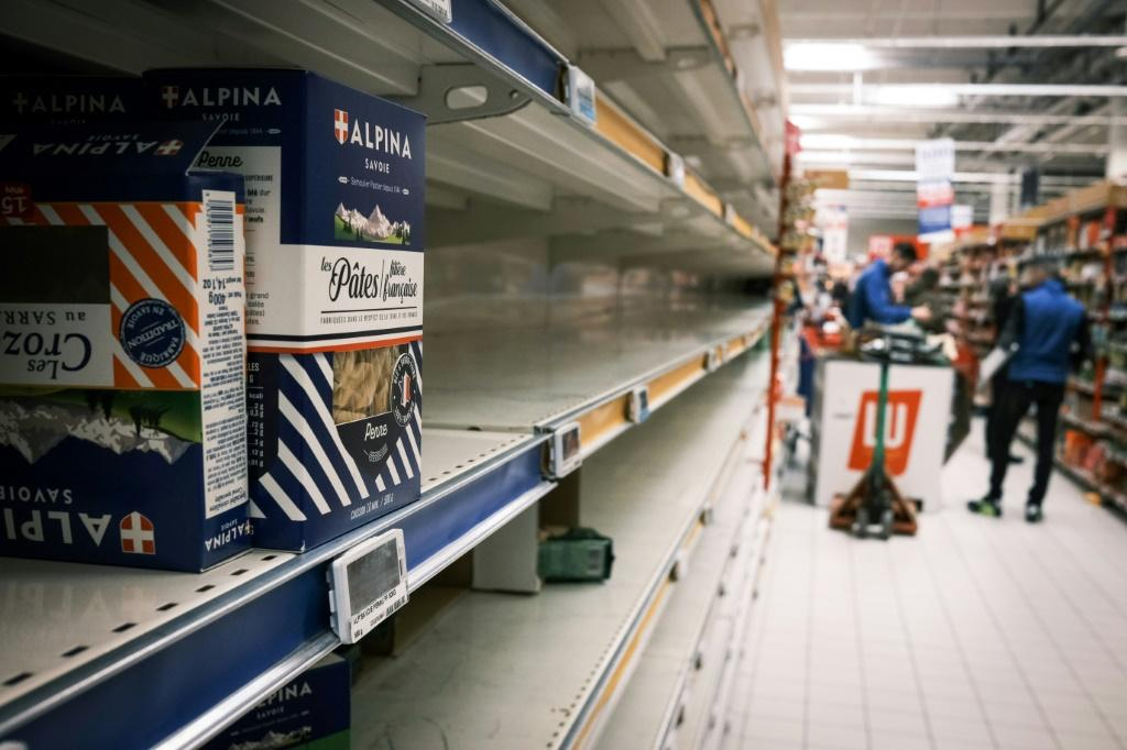 Empty shelves after shoppers spooked by the coronavirus outbreak stock up on pasta to help get them through the crisis