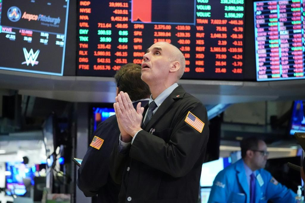 Traders work on the floor at the opening bell at the New York Stock Exchange on March 18