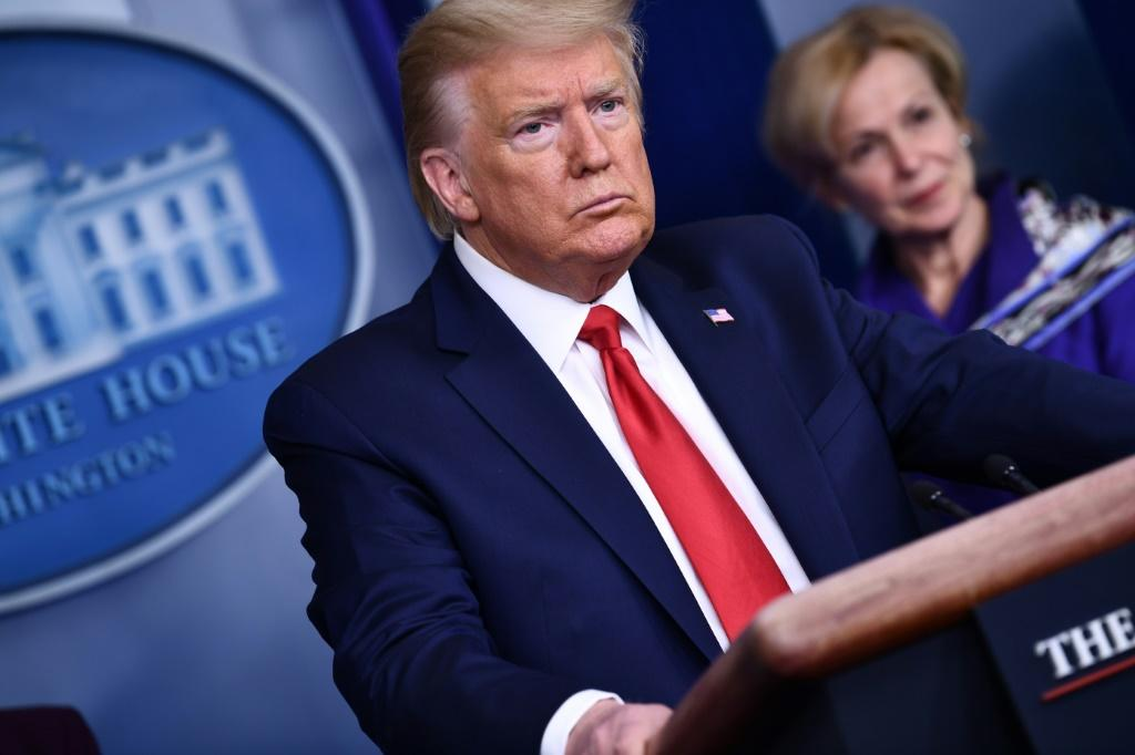 US President Donald Trump listens to a question during the daily briefing on the novel coronavirus on March 18